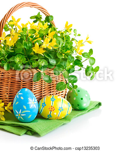easter eggs in basket with spring flowers - csp13235303