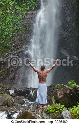 Handsome man at waterfall - csp13236462