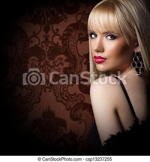 Beautiful blonde woman in luxury fur coat - csp13237255