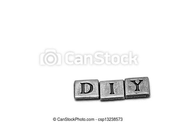 Metal scrapbooking letters spelling DIY - csp13238573