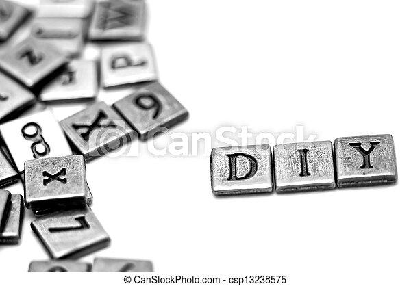 Metal scrapbooking letters spelling DIY - csp13238575