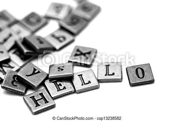 Metal scrapbooking letters spelling Hello - csp13238582