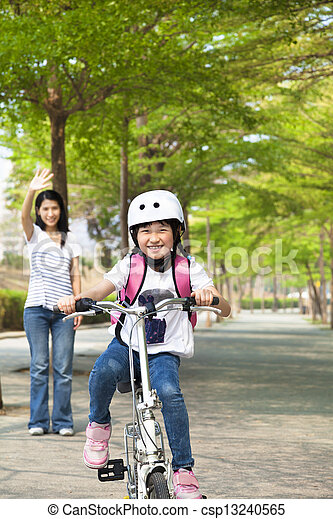 happy little girl riding bicycle go to school - csp13240565