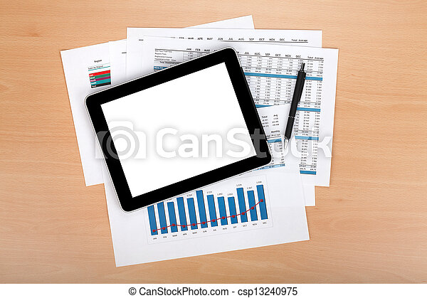 Tablet with blank screen over papers with numbers and charts - csp13240975