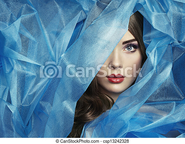 Fashion photo of beautiful women under blue veil - csp13242328