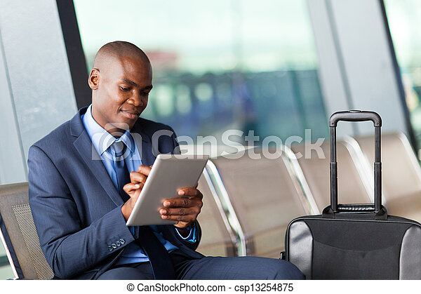 businessman using tablet computer airport - csp13254875