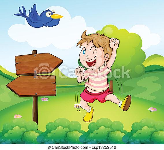 A boy beside a wooden arrow and the blue bird - csp13259510