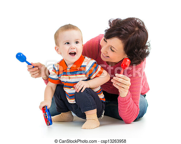 Mother and baby boy having fun with musical toys. Isolated on white background - csp13263958