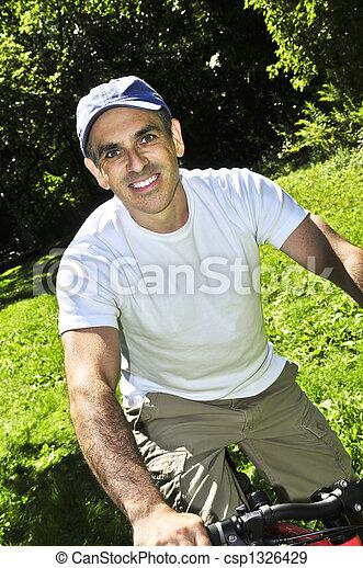 Man riding a bicycle - csp1326429
