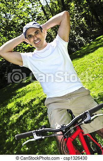 Man riding a bicycle - csp1326430
