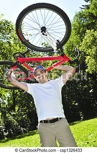 Man carrying a bicycle - csp1326433