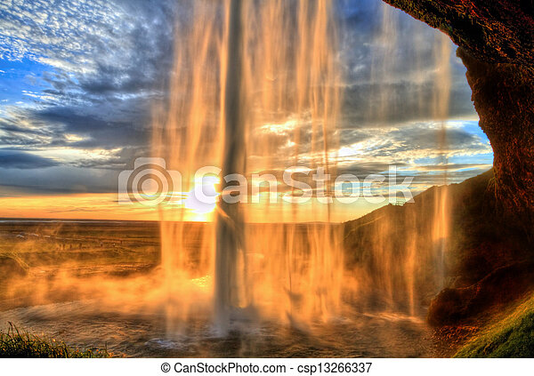 Seljalandfoss waterfall at sunset in HDR, Iceland - csp13266337