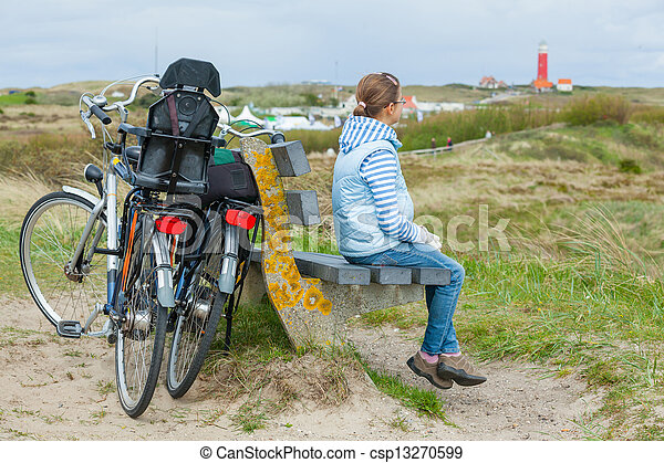 Girl with the bike in the park - csp13270599