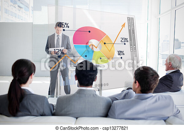 Business people listening and looking at colorful pie chart interface in a meeting - csp13277821