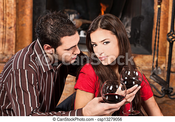 couple in love near fireplace - csp13279056