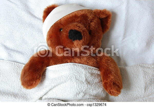 sick teddy with injury in bed - csp1329674