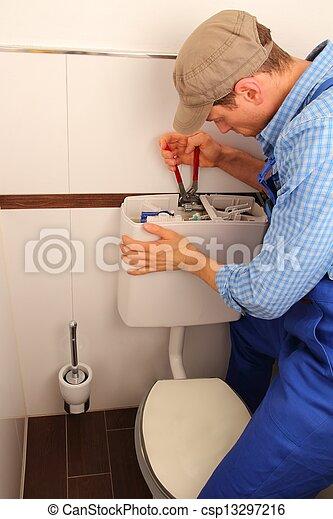 Young craftsman repairing Toilet - csp13297216