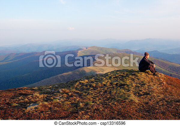Man sitting on top of a mountain - csp13316596