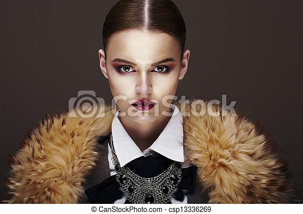 Beautiful Fashionable Strict Fashion Model in Fur Coat. Luxury - csp13336269