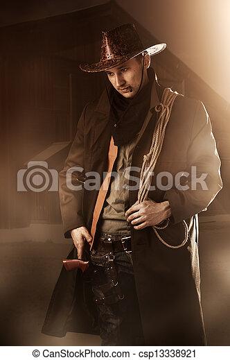 handsome man in cowboy clothes  - csp13338921