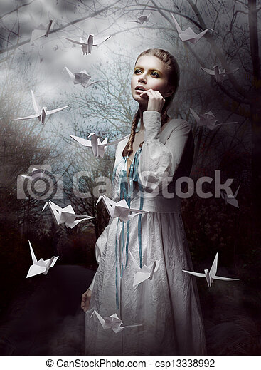 Night. Woman in  Mysterious Forest launching handmade paper Cranes. Origami - csp13338992