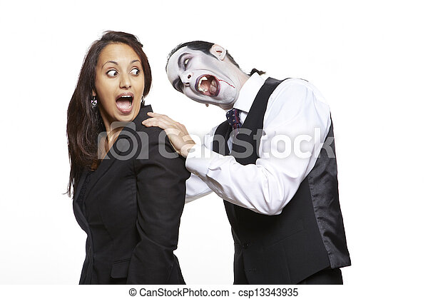 Man in dracula fancy dress costume biting girls neck - csp13343935