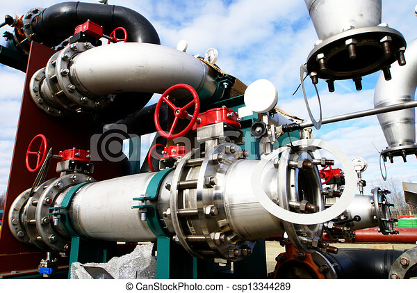 Industrial zone, Steel pipelines and valves against blue sky - csp13344289