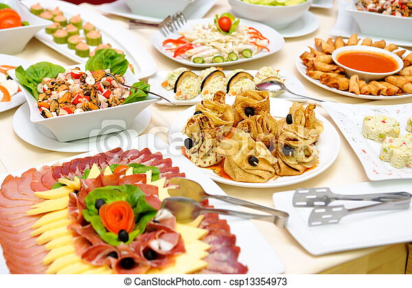 Table with delicious food - csp13354973
