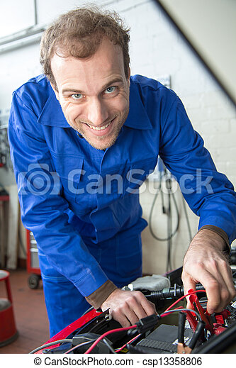 Car mechanic repairing a automobile - csp13358806