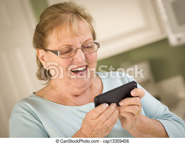 Senior Adult Woman Texting on Smart Cell Phone - csp13359456
