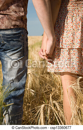Loving couple holding hands on nature - csp13360677