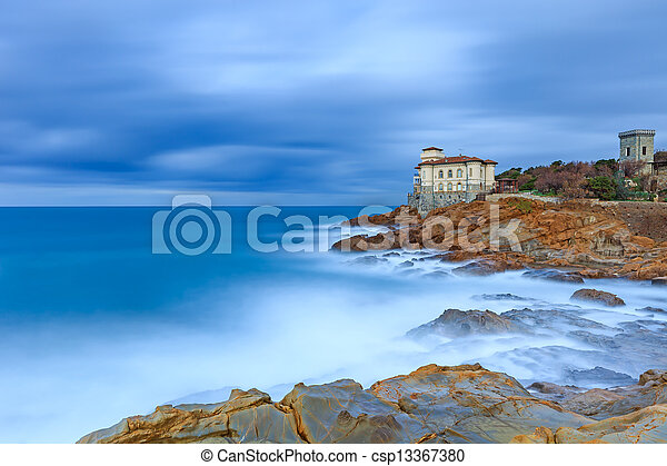 Boccale castle landmark on cliff rock and sea. Tuscany, Italy. Long exposure photography. - csp13367380