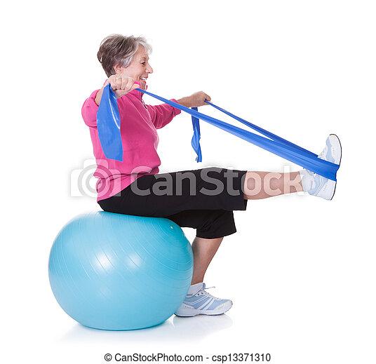Senior Woman Stretching Exercising Equipment - csp13371310