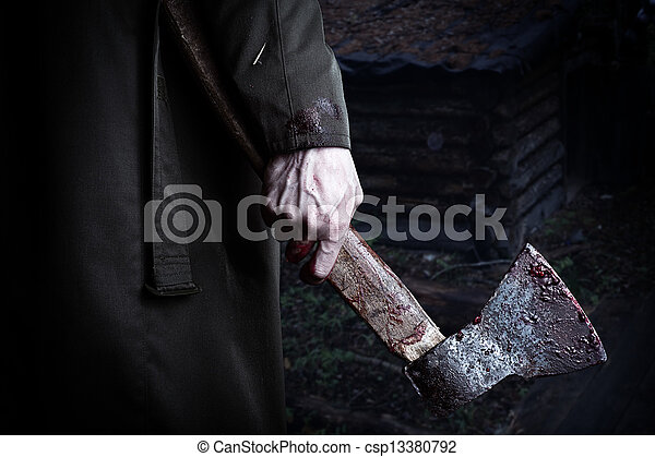 Axe with blood in male hand  - csp13380792