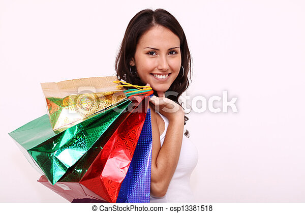 portrait of one happy young adult girl with colored bags - csp13381518