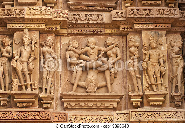 Erotic sculptures decorating the ancient Kandariya Mahadeva Hindu Temple at Khajuraho, Uttar Pradesh, India. 11th Century AD.