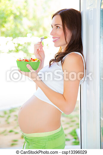 Pregnant woman eating salad - csp13396029