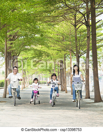 happy family riding bicycle in the park - csp13398753