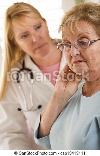 Senior Adult Woman Being Consoled by Female Doctor or Nurse - csp13413111