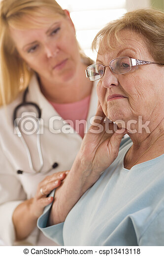 Senior Adult Woman Being Consoled by Female Doctor or Nurse - csp13413118