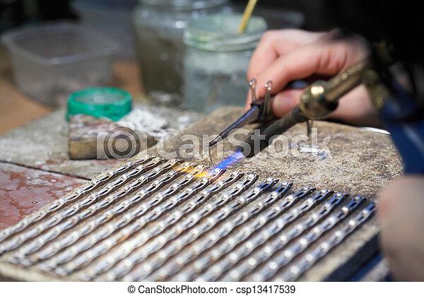 stock fotos von h nde juwelier arbeit silber l ten csp13417539 suchen sie stock bilder. Black Bedroom Furniture Sets. Home Design Ideas