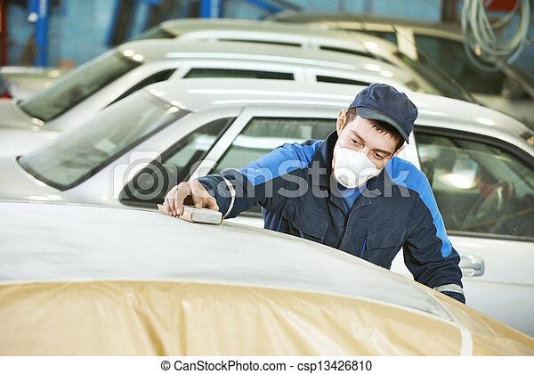 repairman sanding automobile roof - csp13426810