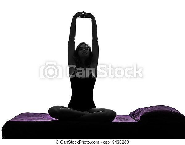 woman in bed waking up stretching arms silhouette - csp13430280