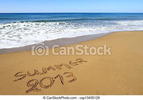 """""""Summer 2013"""" written on sandy beach - csp13435129"""