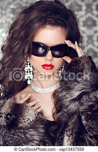Luxury and Fashion Portrait of stylish woman model with sunglasses - csp13437559