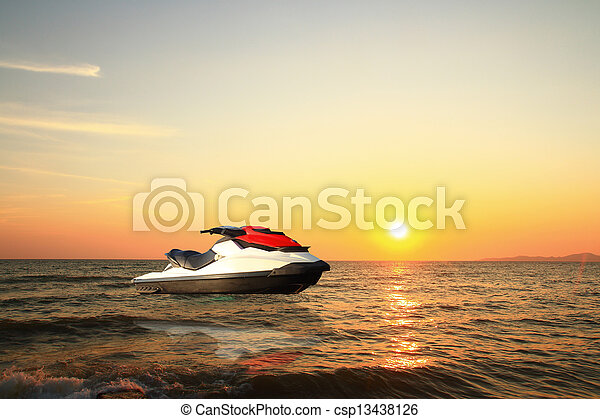 jetski above the water at sunset - csp13438126