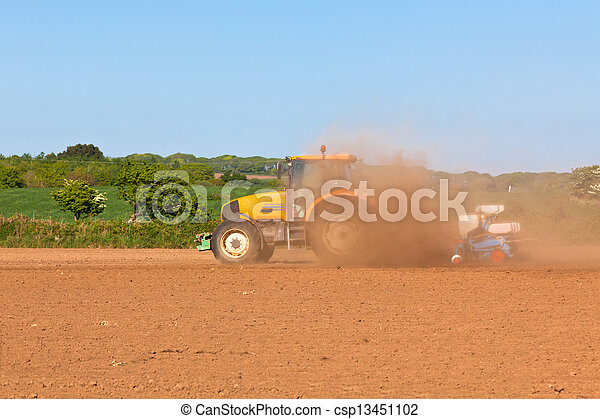 Agriculture - Tractor on the field - csp13451102