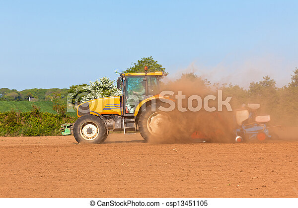 Agriculture - Tractor with plowes on the spring field - csp13451105