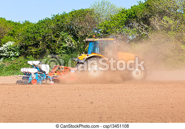 Agriculture - Tractor on the field - csp13451108