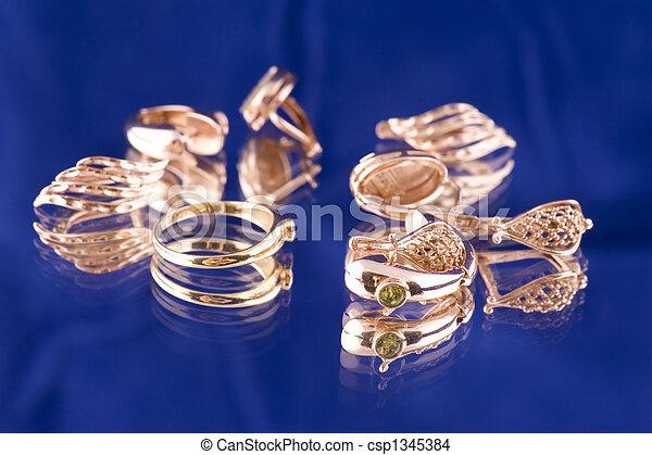 Golden valuable on blue macro - csp1345384